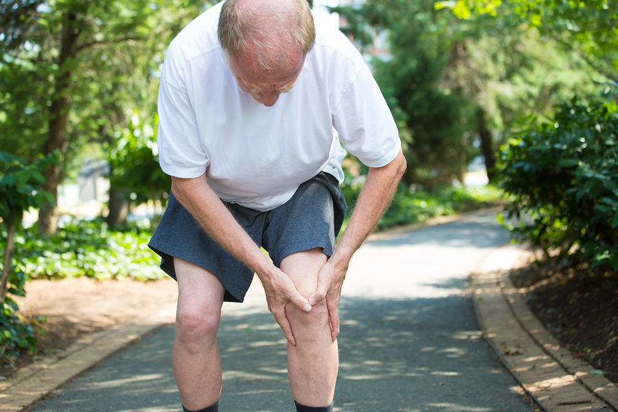 Senior man with pain in knee